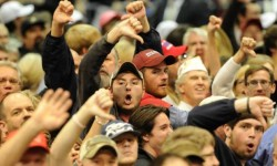 Trump supporters 'boo' the media after a heckler was removed as Republican presidential candidate Donald Trump speaks during a campaign stop Saturday, Nov. 21, 2015 in Birmingham, Ala. (AP Photo/Eric Schultz)